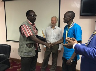 President of RC Kampala with Jim McWhirter and Rogers Kubuye